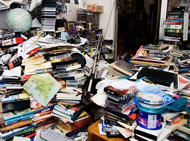 disorganized hoard of books and media